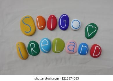 Sligo, Ireland, souvenir with colored stones over white sand