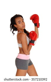 A slim African American girl standing during boxing exercise