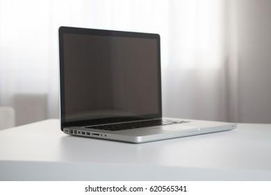 slim aluminium laptop/notebook on desk