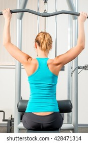 Slim athletic girl in the gym training