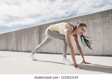 slim athletic girl prepared to run a long distance, outdoors