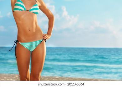 Slim and beautiful on the beach