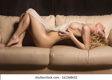 Slim beautiful woman laying on sofa