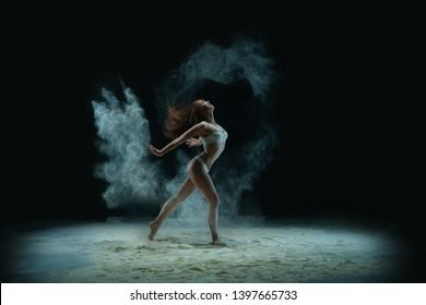 Slim blonde in lingerie in dust profile shot