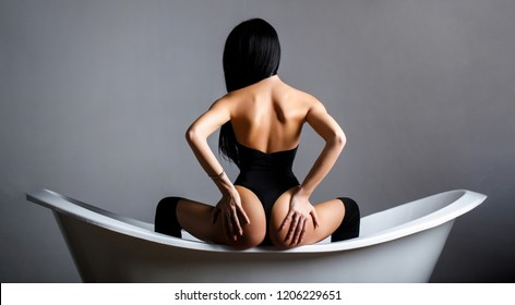 Slim body, waist. Girl with perfect waist. Sexy waistline. Hand of the ass. Naked girl, sexy nude woman. Sexy ass, sensual woman body. Female ass. Sexy buttocks. Bathroom woman. Girl in the bath.