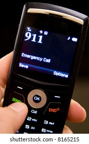A slim cell phone in hand ready to dial 911 in an emergency situation.