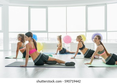 Slim curious girls in fitness club