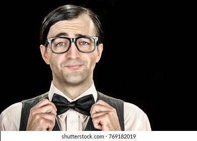 slim elegant nerd with glasses and bow tie portrait on black background