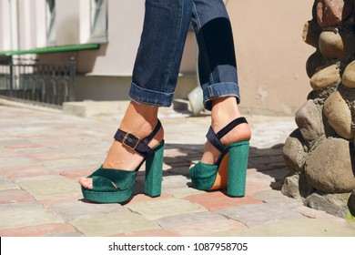 Slim female legs in jeans and comfort shoes outdoor