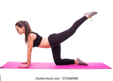 Slim fitness young woman Athlete girl doing plank exercise with legs on white background concept training workout crossfit gymnastics cross fit.