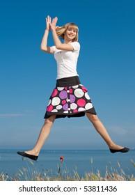 Slim girl jumping