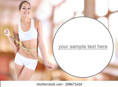 Slim girl with tape on bright background