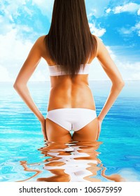 slim healthy woman body in the sea water