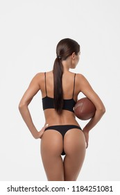 Slim lady booty with rugby ball