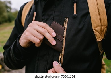 Slim leather wallet for men in pocket