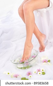 Slim legs in aromatherapy bowl, composition sided