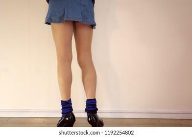 Slim legs of denim miniskirt