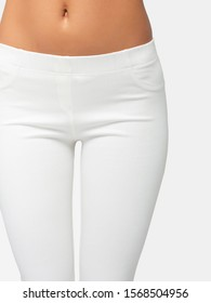 slim legs of a young girl in leggings on a white background. Concept of a fit figure and the absence of problem areas. Advertising space.
