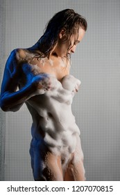 Slim nude blonde rubbed with soap cropped view