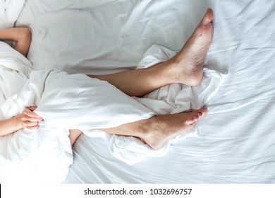 Slim, perfect and beautiful woman legs on bed
