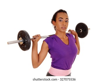 A slim pretty african american woman lifting weight, standing isolatedfor white background with the weight behind her head.