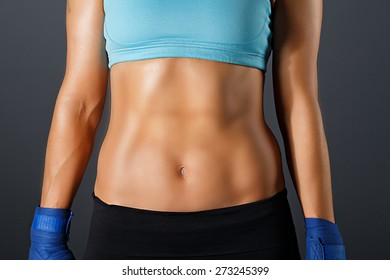 Slim sportive woman torso with strong abdominal  muscles
