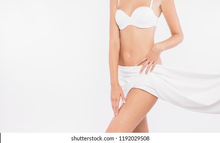 Slim tanned woman's body isolated over white background. Healthy lifestyles concept.