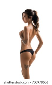 Slim tattooed girl topless rearview shot