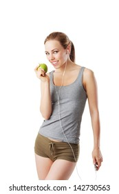 Slim woman after fitness workout going to eat an green apple isolated on white