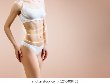 Slim woman body with glowing circles shows lifting effect. Over beige background.