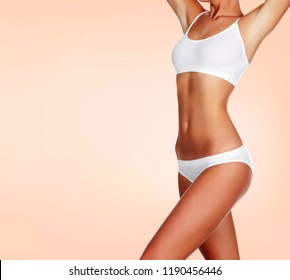 Slim woman body on a pastel background