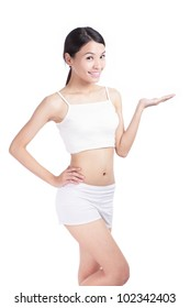 Slim woman body and she smile introduce something on empty copy space isolated over white background, ,model is a asian beauty