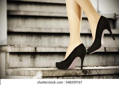 slim woman legs and heels