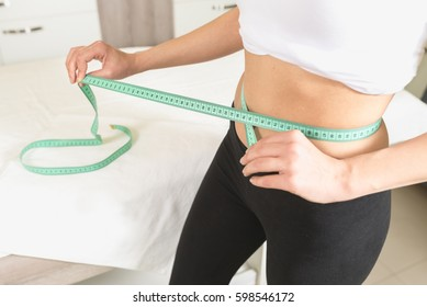 Slim woman measure waist