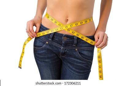 Slim woman measuring her waist