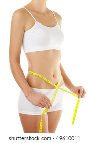 Slim woman measuring her waist isolated on white background