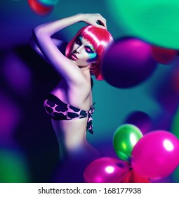 slim woman with pink wig in balloons