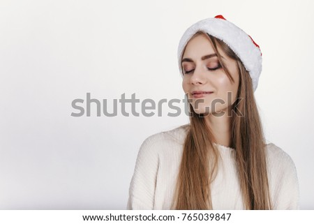 f4b7dd7ae77e2 Slim young girl dreaming about christmas. Pretty young model with blonde  long hair