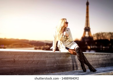Slim young woman and Paris city at autumn. Free space for your decoration.