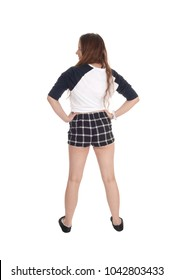 A slim young woman standing in a checkered shorts with her