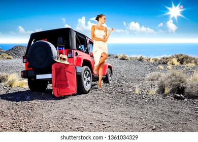 Slim young woman in summer dress. Red car on road and sea landscape.