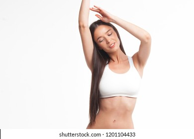 Slim young woman in underwear on white background. Skin and body care concept