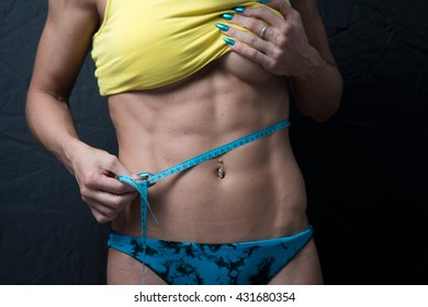 slimming, healthy lifestyle, sports diet, woman measures a herself after a workout, fitness motivation,