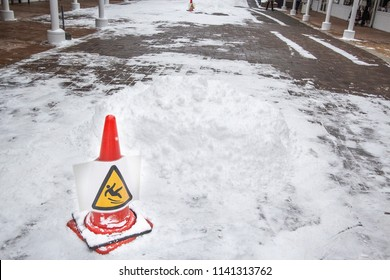 Slip on the slip ice and snow on the ground. Warning sign
