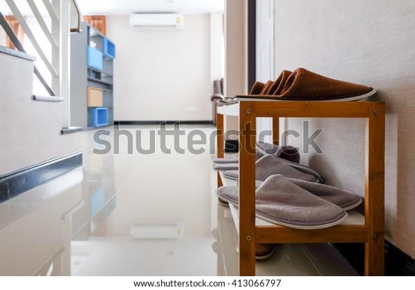 slipper shelf in front of door.