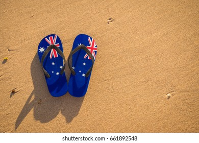 6a8419a90bcf17 Slippers with Australian flag on the beach at sunset