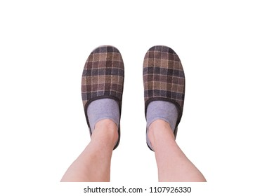 Slippers in cage on legs isolated on white background. Slippers for home