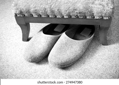 slippers and footstool in black and white design