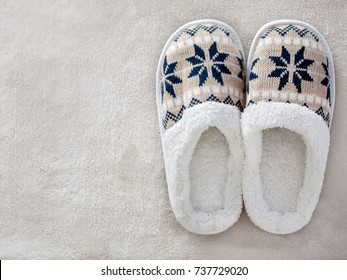 Slippers on the carpet. Soft comfortable home slipper