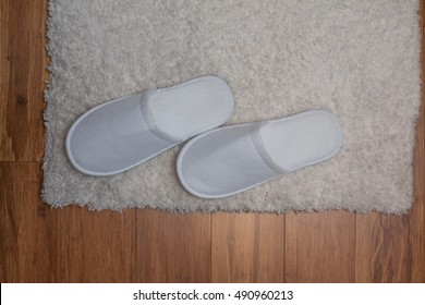Slippers on Rug